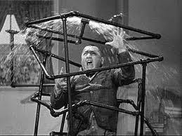 Curly Howard, plumbing himself in a shower, in the Three Stooges short film, A Plumbing We Will Go
