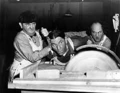 Moe, Larry and Shemp as dangerously inept woodworkers in A Snitch in Time