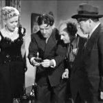 "Bea (Christine McIntyre) being ""interrogated"" by Shemp, Moe and Larry, mistakenly thinking that the 3 would-be reporters are police detectives"