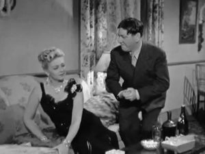 Trying to change their minds, Bea (Christine McIntyre) plies her wiles on Shemp