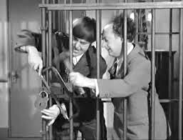 Trapped in the gorilla cage, Moe and Larry try to escape