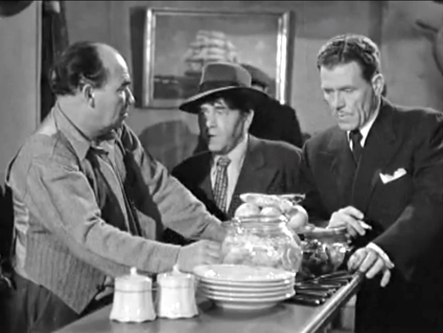 Would-be reporters Moe, Larry and Shemp question the bartender at a seedy waterfront dive, looking for Dapper – not realizing that he's standing next to them
