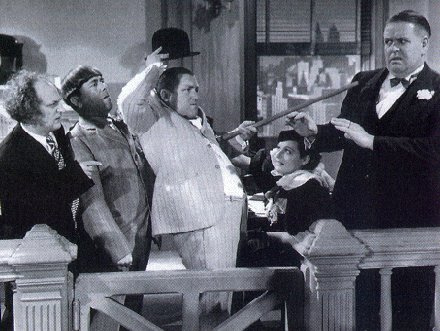 The Three Stooges (with Bud Jamison) in a scene from Disorder in the Court