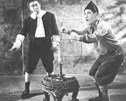 Publicity photo for Fiddlers Three - Moe as Simple Simon, Shemp as Jack Be Nimble