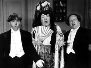 Micro-phonies starring the Three Stooges (Moe Howard, Curly Howard, Larry Fine) and Christine McIntyre