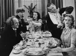The Three Stooges (Moe, Larry, Curly) ruining a dinner party in Three Sappy People, shaving one of the guests
