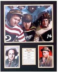 Another still from Three Little Pigskins, colorized this time, showing Curly, Moe and Larry in their uniforms and helmets.